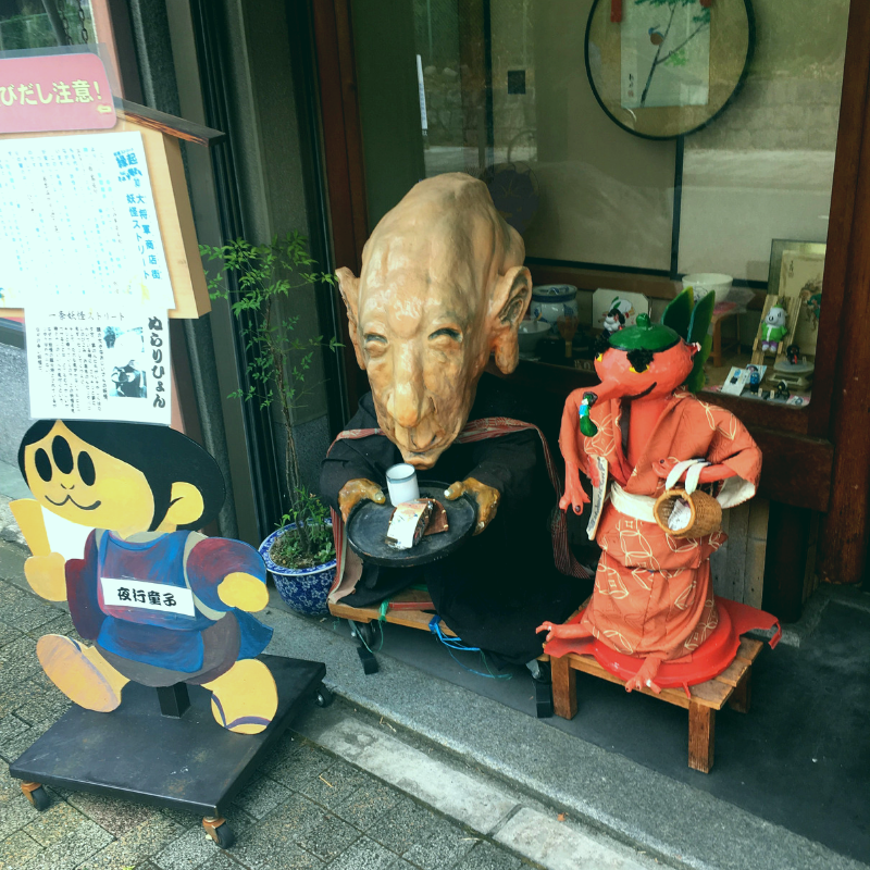 Yokai in front of a shop on Yokai Street